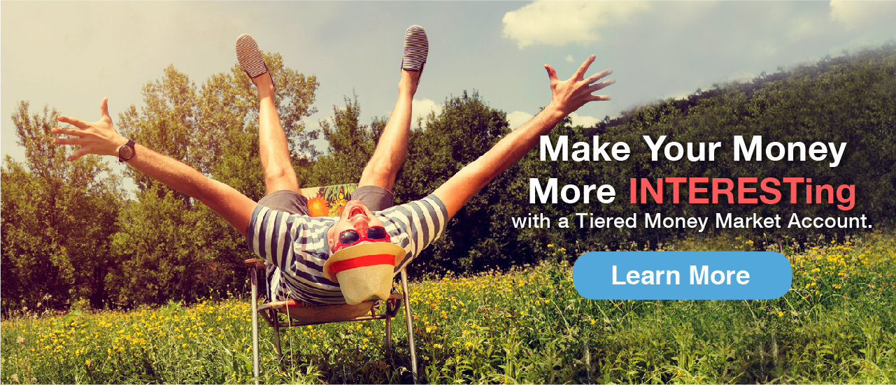 Man in fedora flipping over bushes. My what a strong wind there must be! Make more with a tiered money marketing account. Ask today.