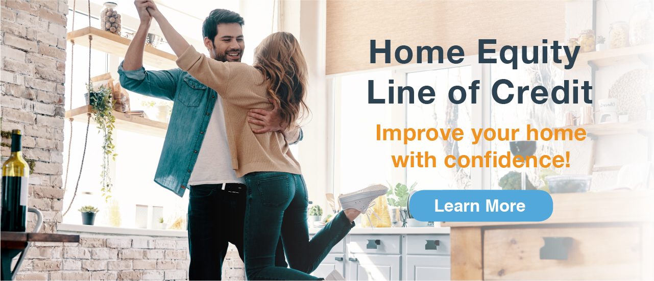 guy picking up lady and she has her foot in the air text says home equity line of credit improve your home with confidence
