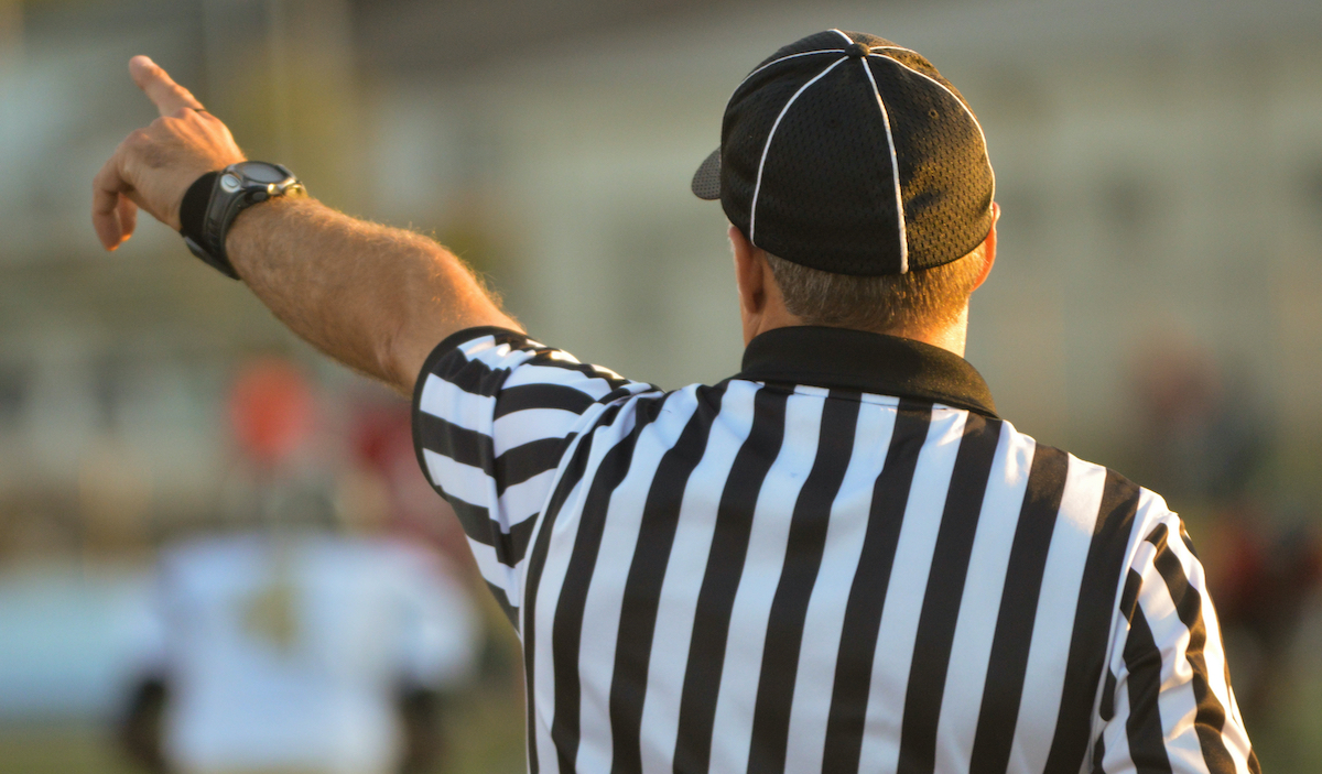 Referee with Arm Outstretched