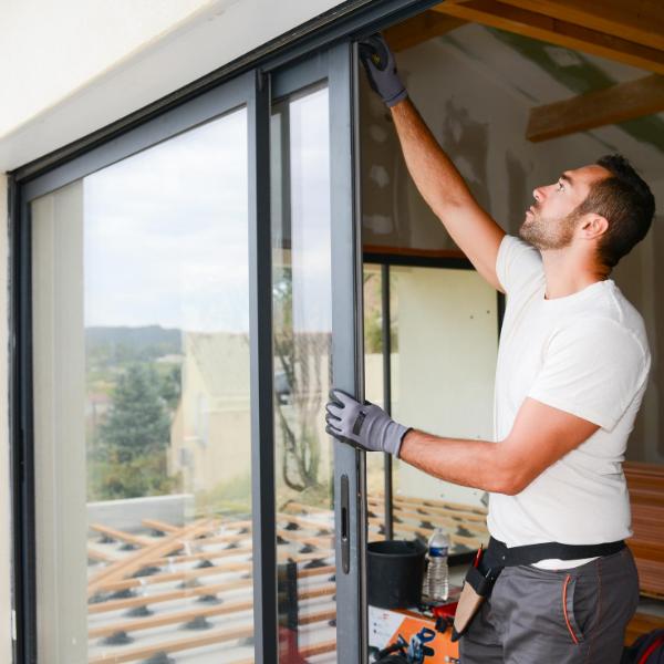 guy replacing glass bay windows
