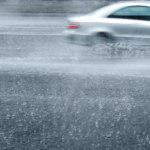car driving in very wet conditions
