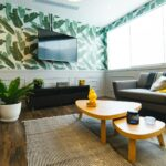 brightly lit room with a tropical decor scheme